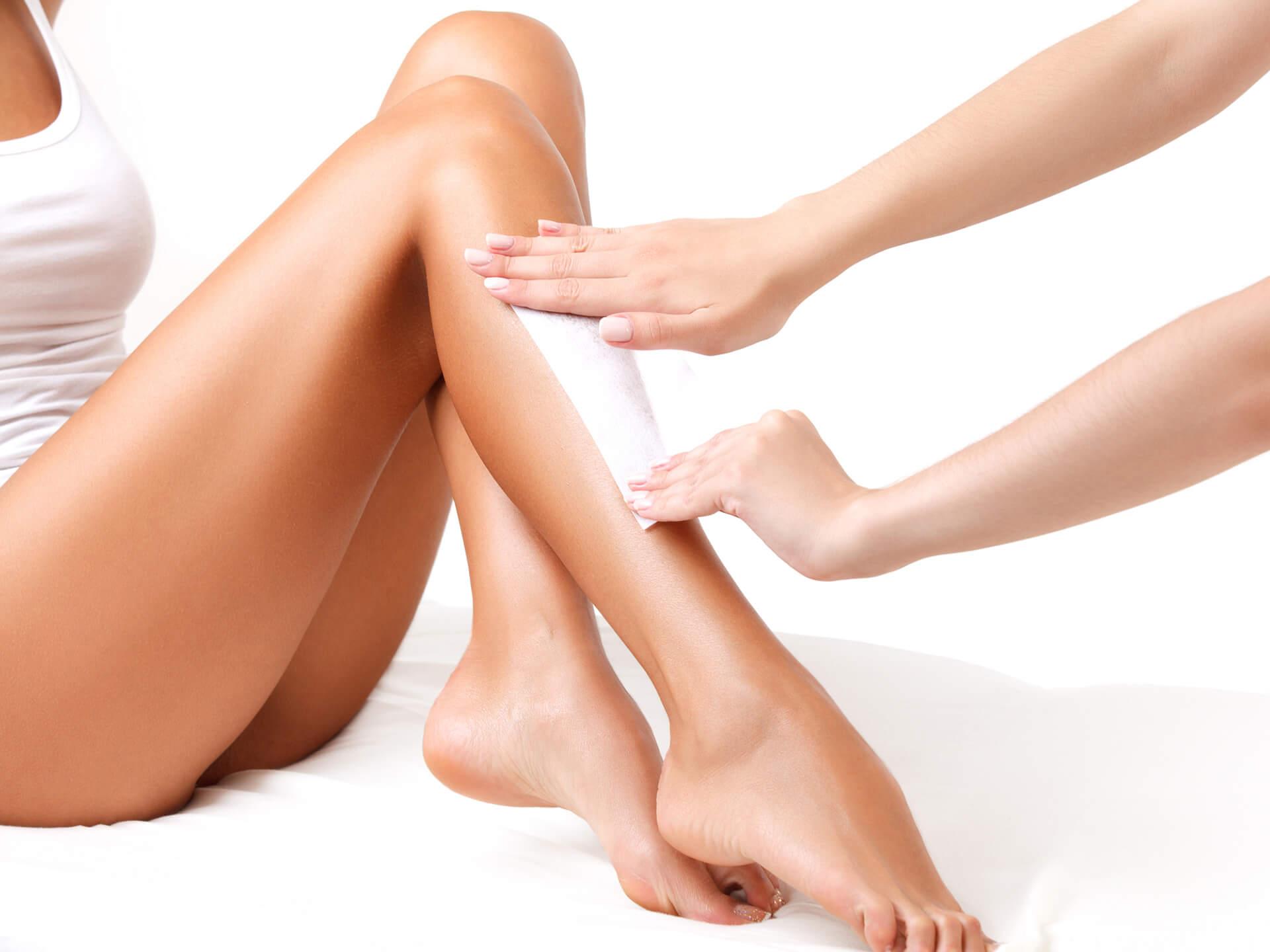 Women leg waxing by The Lash & Wax Boutique - Seattle, WA